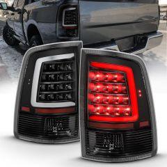 DODGE RAM 1500 09-18/ 2500 3500 10-18 LED TAIL LIGHTS BLACK HOUSING CLEAR LENS W/ C LIGHT BAR (NOT COMPATIBLE W/ ORIGINAL LED VERSION)