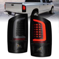 DODGE RAM 02-06 LED TAIL LIGHTS BLACK HOUSING CLEAR LENS W/ C LIGHT BAR